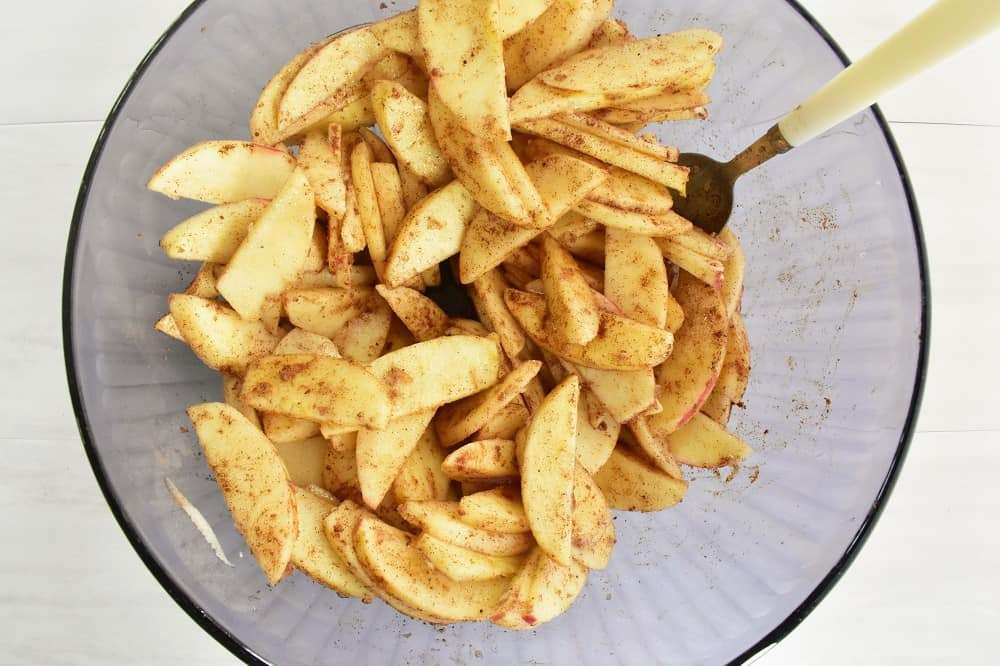 Sliced apples tossed with cinnamon, butter, and maple syrup