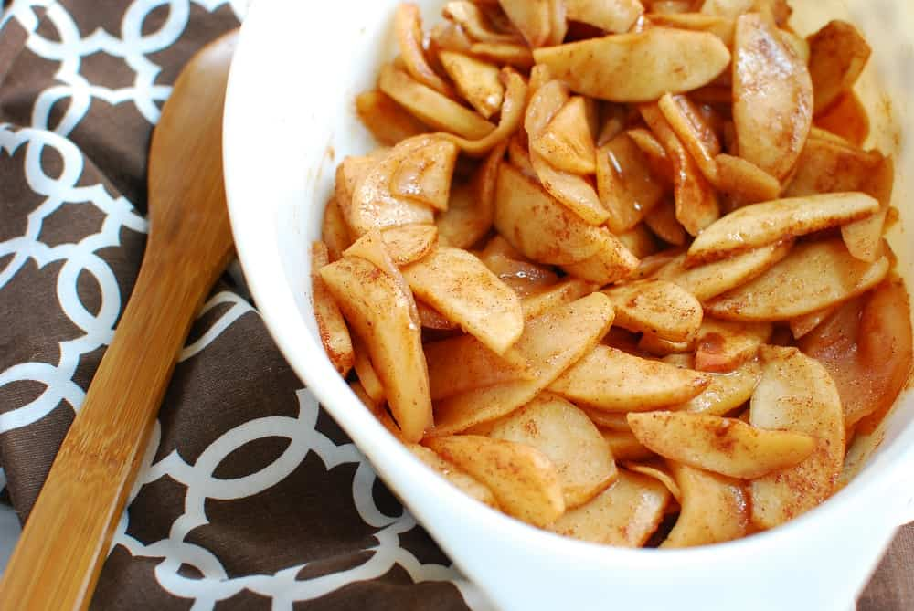 Healthy baked cinnamon apples in a casserole dish