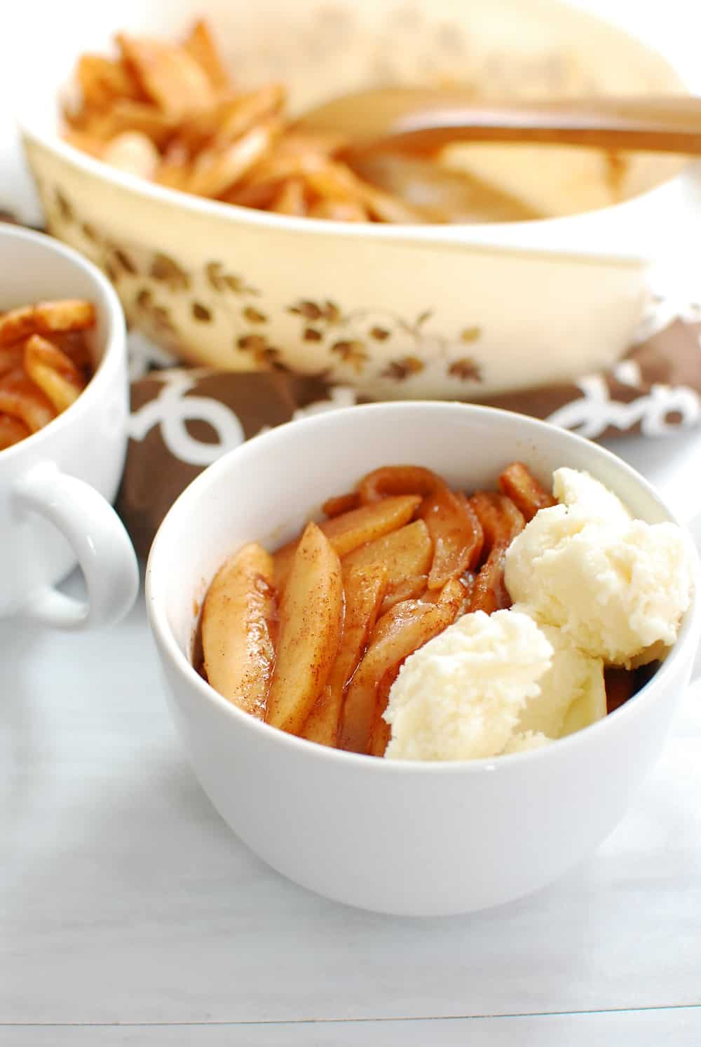 Baked cinnamon apples topped with coconut ice cream