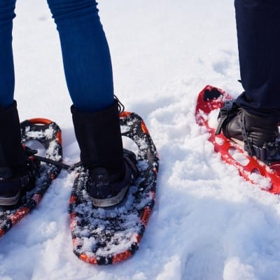 family walking together in snowshoes as a family experience gift