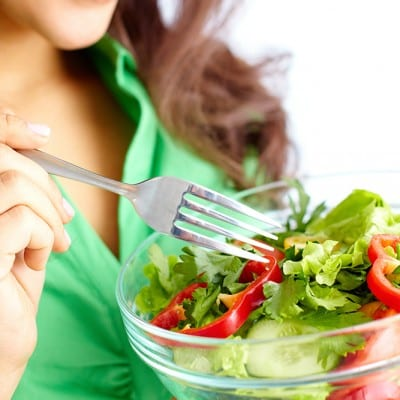 girl eating fresh vegetable salad