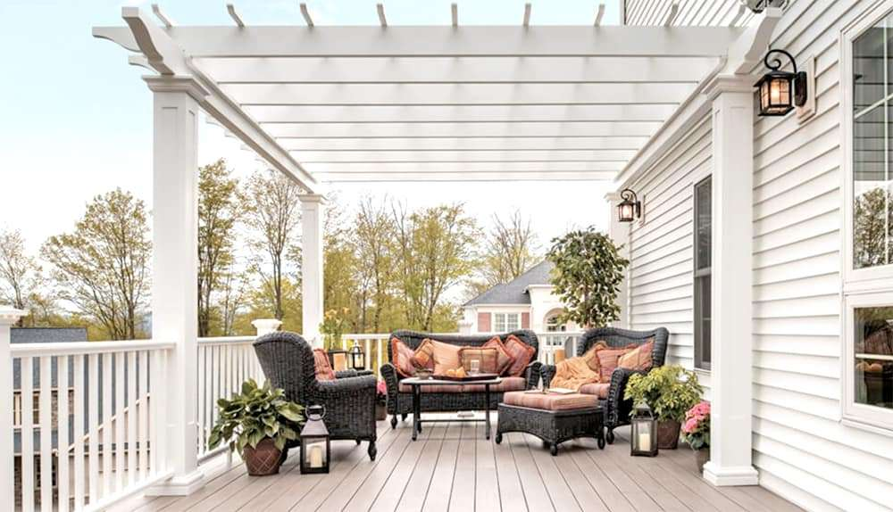 deck with furniture and arbor