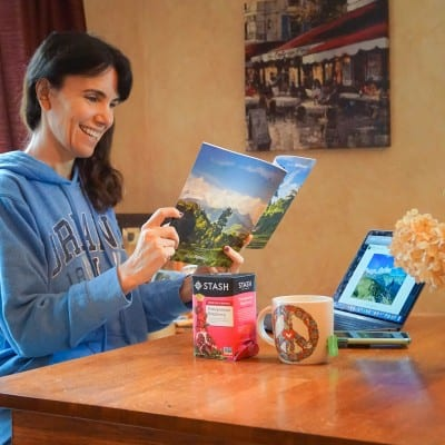 woman reading travel catalog